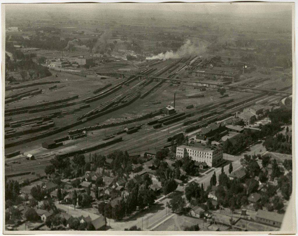 1930 aerial view of the train yard and viaduct into the stockyards. Special Collections Department, Stewart Library, Weber State University