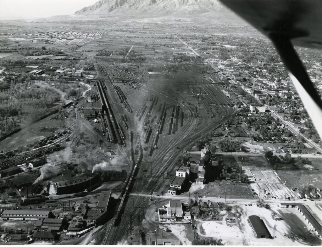 Aerial view of the Ogden train yards with the Ogden Union Stockyards in the background. Special Collections Department, Stewart Library, Weber State University