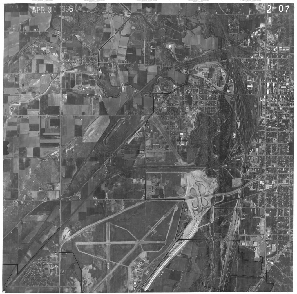 April 30, 1966 aerial view of Ogden including the train yard and the Ogden Union Stockyards. Special Collections Department, Stewart Library, Weber State University