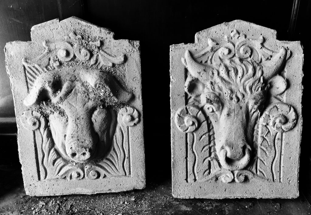 Livestock heads in stone relief from the exterior of the Ogden Union Stockyards Exchange Building. Column detail in lobby of the Ogden Union Stockyards Exchange Building. Photo credit www.Evalogue.Life - Tell Your Story, taken in 2017