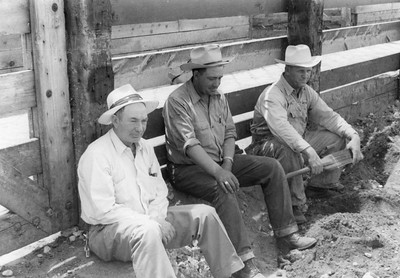 Red Rushton, Brose-Hadley and Eldis Barber, swearing light colored cowboy hats and sitting inside pens at the Ogden Union Stockyards. Thank you to Don Strack for generously sharing this photo, part of his extensive gallery.